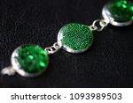 green resin bracelet on a dark... | Shutterstock . vector #1093989503