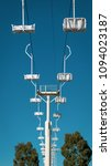 disused chair lift at fairground | Shutterstock . vector #1094023187