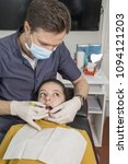 orthodontist in his surgery | Shutterstock . vector #1094121203