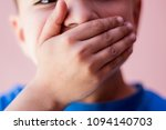 little boy covering mouth with... | Shutterstock . vector #1094140703