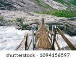 a man crossing a bridge         ... | Shutterstock . vector #1094156597