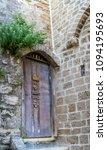 old wooden door with stairs in... | Shutterstock . vector #1094195693