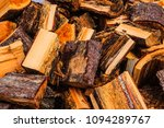a pile of chopped firewood logs ... | Shutterstock . vector #1094289767