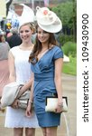 Racegoers  attend Ladies Day at the annual Royal Ascot horse racing event. Ascot, UK. June 21, 2012, Ascot, UK Picture: Catchlight Media / Featureflash - stock photo