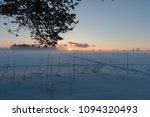 sunset in a snowy field and... | Shutterstock . vector #1094320493