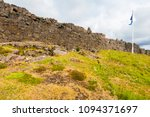 Small photo of Location of Althing, the oldest parliament on the Earth, is marked by Icelandic flag. Thingvellir national park, Iceland