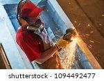 home renovation. worker cutting ...   Shutterstock . vector #1094492477