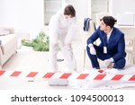 forensics investigator at the... | Shutterstock . vector #1094500013