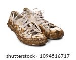 dirty sneakers isolated on white | Shutterstock . vector #1094516717