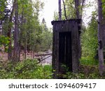 Abandoned Rustic Outhouse In...