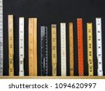 Small photo of Folding rulers and scales in metric and inches form a bar chart and represent concepts of accuracy, measurement and accuracy.