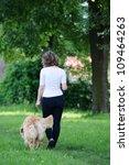 Stock photo woman walking a dog 109464263