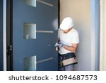 handsome young man installing a ... | Shutterstock . vector #1094687573