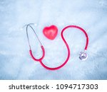 stethoscope and red heart heart ... | Shutterstock . vector #1094717303