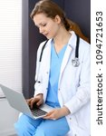 woman doctor typing on laptop... | Shutterstock . vector #1094721653
