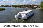 broads cruiser on the river...   Shutterstock . vector #1094725463