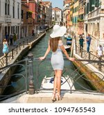 Small photo of Italy beauty, pretty girl on one of attractive canal bridges in Venice , Venezia