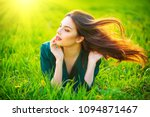 beauty woman lying on the field ... | Shutterstock . vector #1094871467