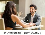 cheerful couple in a restaurant | Shutterstock . vector #1094902577