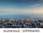 blue sunrise sky over stony... | Shutterstock . vector #1094906483