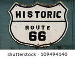 Old historic route 66 sign on the wall - stock photo