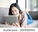 happy young woman with tablet...   Shutterstock . vector #1095000443