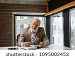 old man with grey hair and... | Shutterstock . vector #1095002453