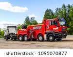 Small photo of Chelyabinsk region, Russia - May 21, 2013: Red tow truck MAN TGA 41.480 at the interurban road.