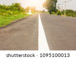 rural road with trees and... | Shutterstock . vector #1095100013
