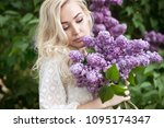 beautiful woman with lilac...   Shutterstock . vector #1095174347