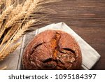 baked bread on wooden table... | Shutterstock . vector #1095184397