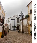 streets of obidos. portugal.... | Shutterstock . vector #1095401477