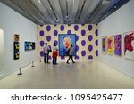 """Small photo of MADRID, SPAIN - APRIL 05, 2018: Visitors in the CaixaForum Madrid consider pictures at the exibition Andy Warhol """"Warhol. Mechanical Art."""""""