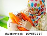 Beautiful new born baby  in his mothers hands. - stock photo