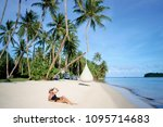 vacation on the seashore.young... | Shutterstock . vector #1095714683