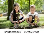 Children planting a new tree. Concept: new life, environmental conservation - stock photo