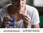 sick ill depressed man holding... | Shutterstock . vector #1095874343