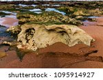 Close Up Of Rock Pools Sand An...