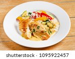 chicken with rice and vegetables | Shutterstock . vector #1095922457