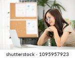 asian woman using laptop ...   Shutterstock . vector #1095957923