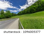 the road is in the mountains in ... | Shutterstock . vector #1096005377