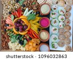 Small photo of A colorful plate of snacks and dips to go along with cocktails and drinks