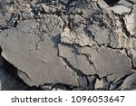 Small photo of Plowed arable land texture, lumps, furrows, cracked pieces of rock background