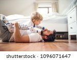 father with a toddler boy... | Shutterstock . vector #1096071647