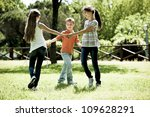 Small group of children playing ring-around-the-rosy - stock photo