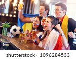 group of friends watching... | Shutterstock . vector #1096284533