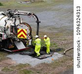 Small photo of Belfast, Northern Ireland - May 22 2018. Environmental waste engineers draining a sewer.