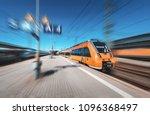 high speed orange train in... | Shutterstock . vector #1096368497