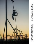 Small photo of Santa Monica, CA / USA - April 25, 2018: American Ninja Warrior Natalie Duran practices her moves on the ropes in Santa Monica, CA