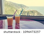 two cups of freshly squeezed... | Shutterstock . vector #1096473257